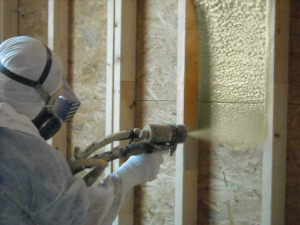Spray Application of Lapolla 4G Spray Polyurethane Foam into wall cavity